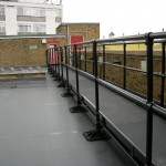 Walkway conservation black on single ply membrane roof